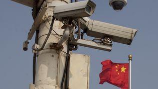 Des caméras de surveillance installées à Pékin (Chine). (ED JONES / AFP)