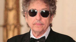 Le 29 mai 2012, Bob Dylan recevaitdes mains d'Obama sa médaille présidentielle de la Liberté. Il n'avait pas dit un mot.  (Owen Sweeney/REX/SIPA)