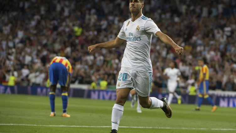 Auteur d'un doublé, Marco Asensio a offert le point du nul au Réal.  (CURTO DE LA TORRE / AFP)