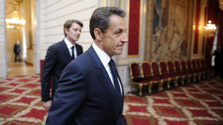 Nicolas Sarkozy et l'ancien ministre de l'Economie, François Baroin, le 26 septembre 2011 au palais de l'Elysée. (ERIC FEFERBERG / POOL / AFP)