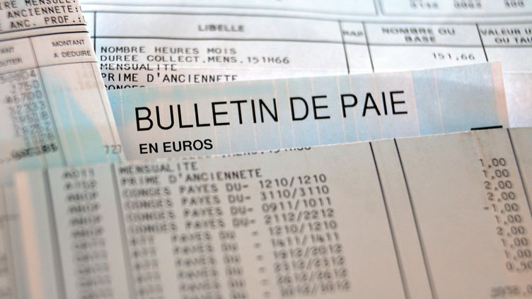 Photo d'illustration d'un bulletin de paie. (PHILIPPE HUGUEN / AFP)
