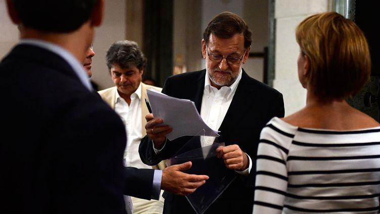 (Rajoy fera voter à la direction de son parti les six conditions que Rivera veut voir accepter avant de négocier l'investiture © AFP)