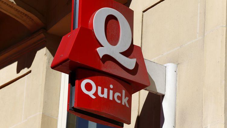 Trois hommes ont braqué un restaurant Quick en septembre 2013 à Coignières (Yvelines), dans l'objectif de financer le départ en Syrie de l'un d'eux. (THOMAS SAMSON / AFP)
