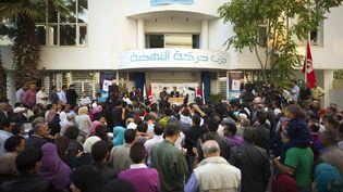 Les membres du parti islamiste tunisien Ennahda se sont rassemblés lundi 24 octobre à Tunis. Aux vues des résultats partiels, le parti estime avoir obtenu 40% des voix. (AFP)