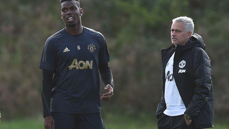 José Mourinho et Paul Pogba (OLI SCARFF / AFP)