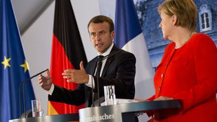 Emmanuel Macron et Angela Merkel lors du sommet franco-allemand, mardi 19 juin 2018 en Allemagne. (EMMANUELE CONTINI / NURPHOTO)
