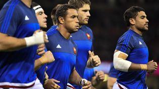 Des joueurs du XV de France lors de leur échauffement avant le quart de finale face à la Nouvelle-Zélande, à Cardiff (pays de Galles), le 17 octobre 2015. (LOIC VENANCE / AFP)