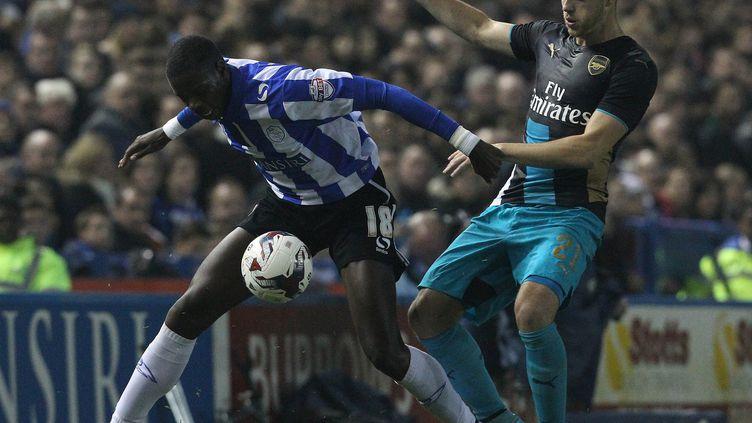 Lucas Joao se joue de la défense d'Arsenal (LINDSEY PARNABY / AFP)