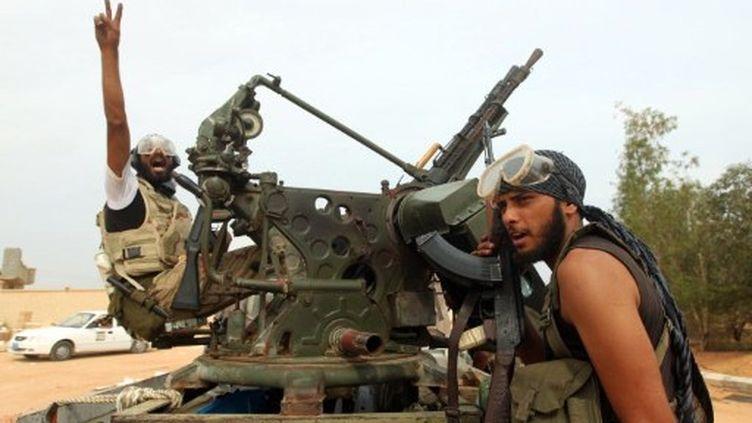 Le secrétaire général de l'Otan s'est dit inquiet de la gestion des armes de l'ancien régime. (AHMAD AL-RUBAYE / AFP)