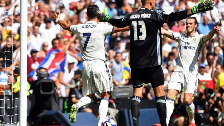 Gareth Bale et Cristiano Ronaldo tout à leur joie (GERARD JULIEN / AFP)