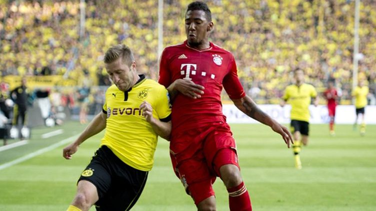 Blaszczykowski (Dortmund) face à Luiz Gustavo (Bayern Munich)