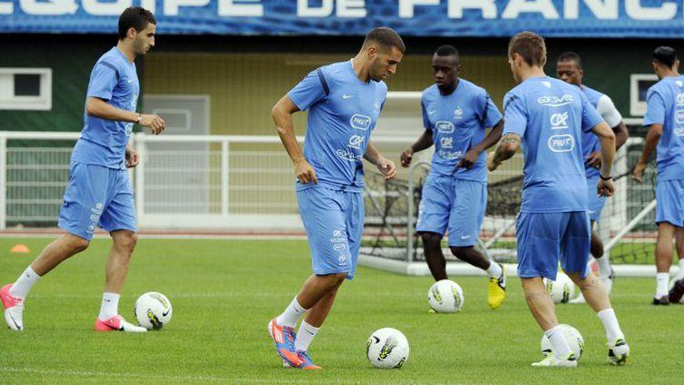 Etienne Capoue et Maxime Gonalons à Clairefontaine (BERTRAND GUAY / AFP)