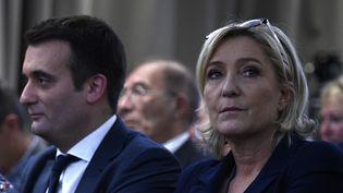 La présidente du FN, Marine Le Pen et Florian Philippot lors d'un meeting à Paris, le 9 décembre 2016. (MARTIN BUREAU / AFP)