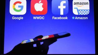 Les logos des Gafa, (Google, Apple, Facebook et Amazon). (DAMIEN MEYER / AFP)
