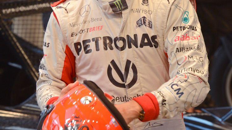 Michael Schumacher à Bangkok (Thaïlande), le 16 décembre 2012. (PORNCHAI KITTIWONGSAKUL / AFP)
