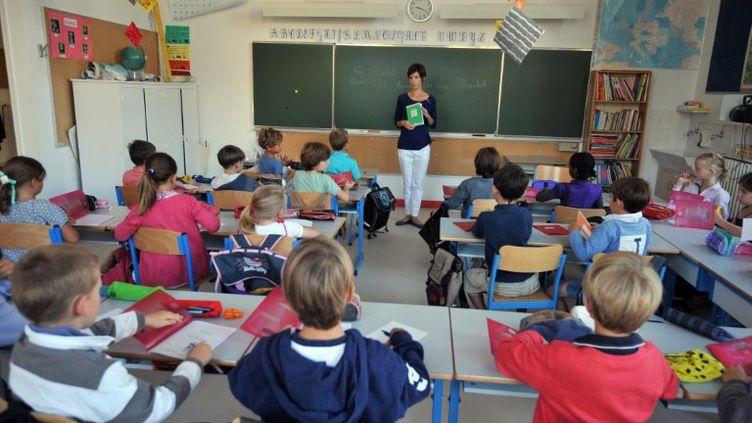 Des élèves de l'école Harouys à Nantes (Loire-Atlantique), le 5 septembre 2011, jour de la rentrée scolaire. (FRANK PERRY / AFP PHOTO)