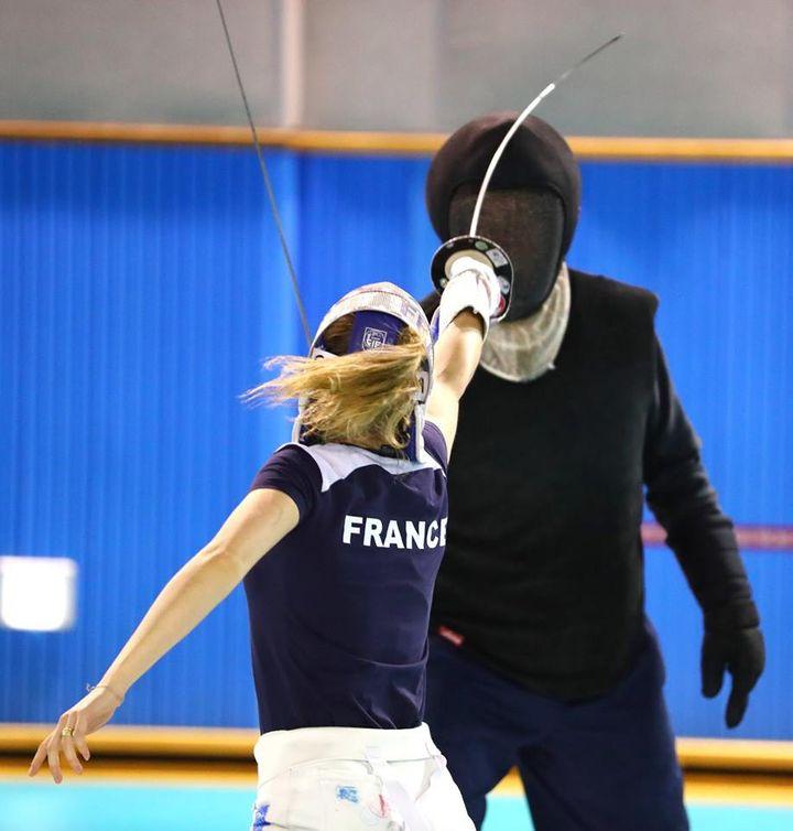 Charleine Taillandier en leçon avec Jean Philippe Daurelle avant d'entrer en piste au Grand Prix de Séoul. (BIZZI TEAM)