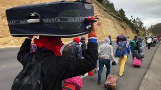 ATulcán (Pérou), le 21 août 2018, des migrants vénézuéliens marchent vers l'intérieur du pays, avant que de nouvelles règles ne leur soient imposées, comme la détention d'un passeport valide. (ANDRES ROJAS / Reuters)