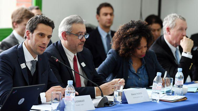 Le président du comité d'organisation des Jeux olympiques de Paris 2024 Tony Estanguet, le directeur général Etienne Thobois, et la ministre des Sports Laura Flessel, le 2 mars 2018 au Bourget (Seine-Saint-Denis). (PHILIPPE MILLEREAU / DPPI MEDIA / AFP)