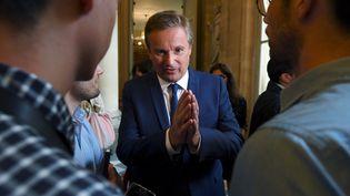 Nicolas Dupont-Aignan à l'Assemblée nationale, à Paris, le 27 juin 2017. (CHRISTOPHE ARCHAMBAULT / AFP)