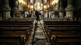 Une messe célébrée à Lyon, le 25 mars 2020. (ANTOINE MERLET / HANS LUCAS / AFP)