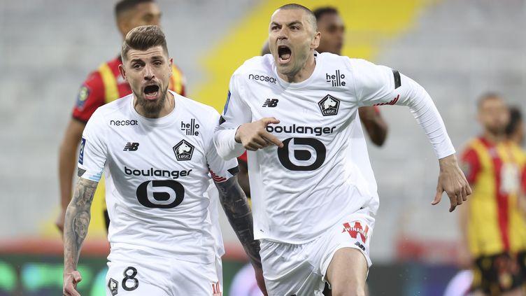 La joie explosive deBurak Yilmaz après l'un de ses deux buts inscrits contre Lens, lors de la 36e journée de Ligue 1 le 7 mai 2021. (MAXPPP)