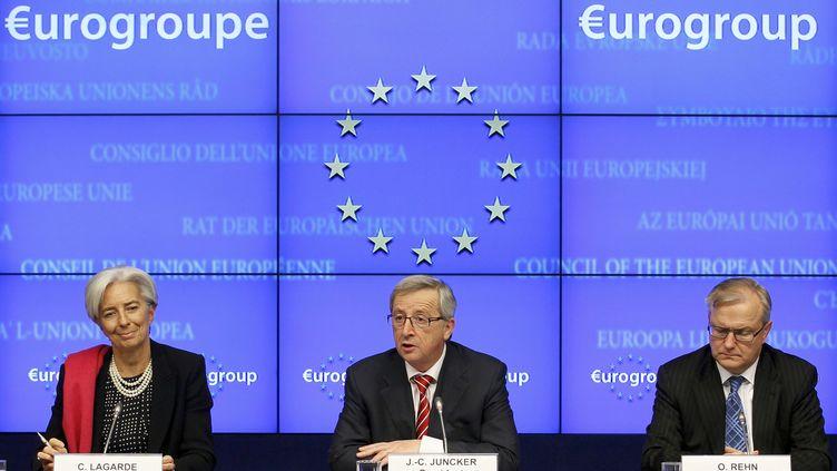 Réunis à Bruxelles (Belgique) le 21 février 2012, de gauche à droite : Christine Lagarde (FMI), Jean-Claude Juncker (Eurogroupe) et Ollie Rehn (Commission européenne). (REUTERS)
