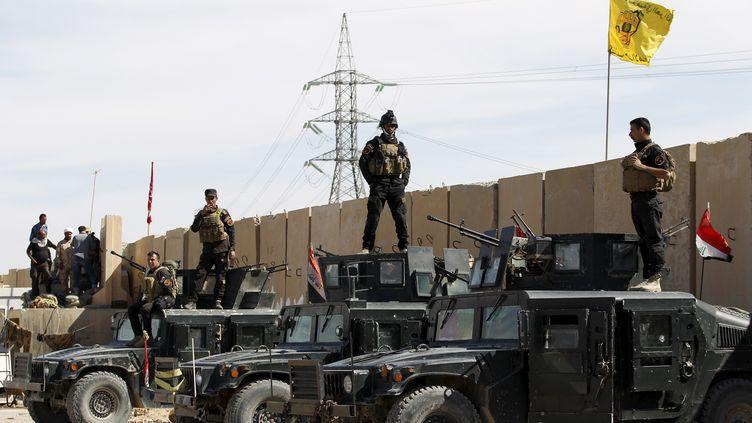 Les forces irakiennes dans Tikrit (Irak), le 27 mars 2015. (THAIER AL-SUDANI  / REUTERS)