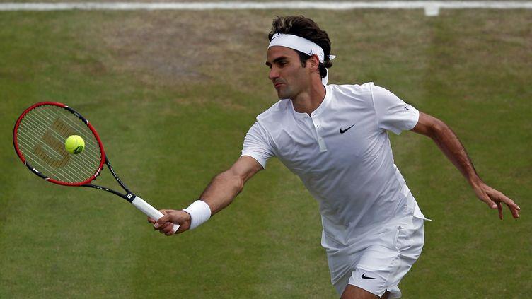 Roger Federer dans ses oeuvres (ADRIAN DENNIS / AFP)