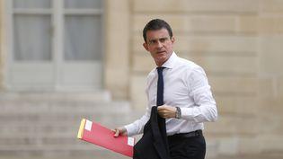 Le Premier ministre, Manuel Valls, arrive à l'Elysée, le 16 juillet 2016 à Paris. (MATTHIEU ALEXANDRE / AFP)