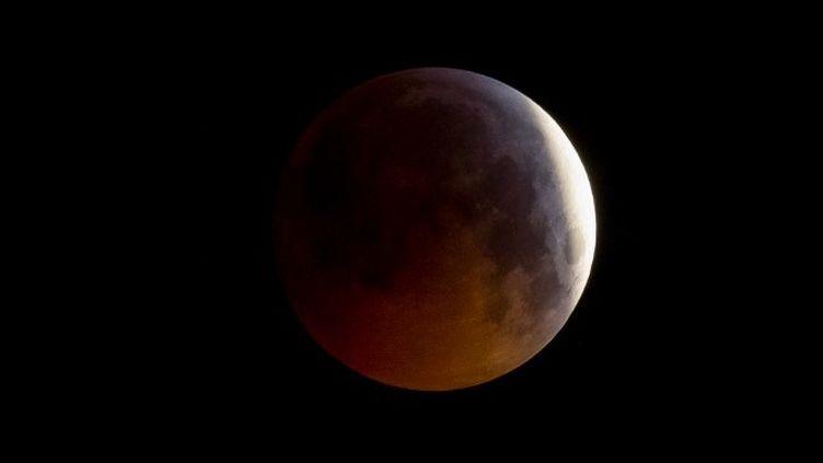 Eclipse de Lune, janvier 2019, Paris  (GUILLAUME SOUVANT / AFP)