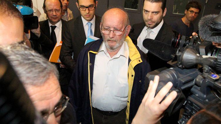 Le fondateur de PIP, Jean-Claude Mas, à son arrivée au procès des prothèses mammaires défectueuses, à Marseille, le 14 avril 2013. (MAXPPP)
