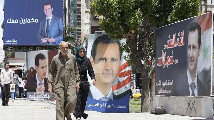 Des affiches électorales de Bachar al-Assad pourl'élection présidentielle du 26 mai 2021, à Damas (Syrie) (LOUAI BESHARA / AFP)