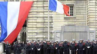 Cérémonie de l'hommage national au policier tué sur les Champs-Elysées. (BERTRAND GUAY / AFP)