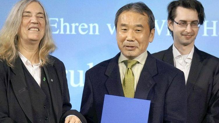Karuki Murakami et Patti Smith à Berlin en 2014 pour le prix littéraire du journal Die Welt  (Takehito Kudo / Yomiuri / The Yomiuri Shimbin / AFP)