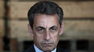 Nicolas Sarkozy a été mis en examen et placé sous contrôle judiciaire mercredi 21 mars à l'issue de sa garde à vue dans le cadre de l'enquête sur l'éventuel financement libyen de la campagne présidentielle de 2007. (FREDERICK FLORIN / AFP)