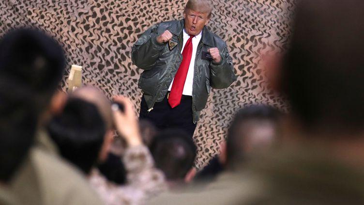 Le présidentaméricain Donald Trump en visite sur la base aérienne d'Al Assad (Irak), le 26 décembre 2018. (JONATHAN ERNST / REUTERS)