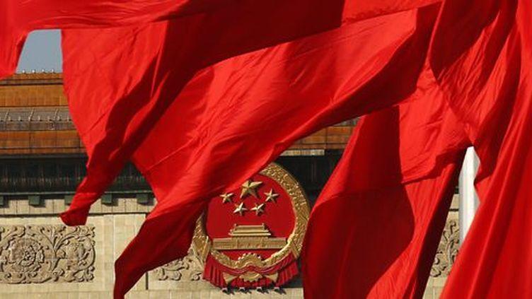 Drapeaux chinois sur la place Tiananmen à Pékin le 12 novembre 2013 (Reuters - Kim Kyung-Hoon)