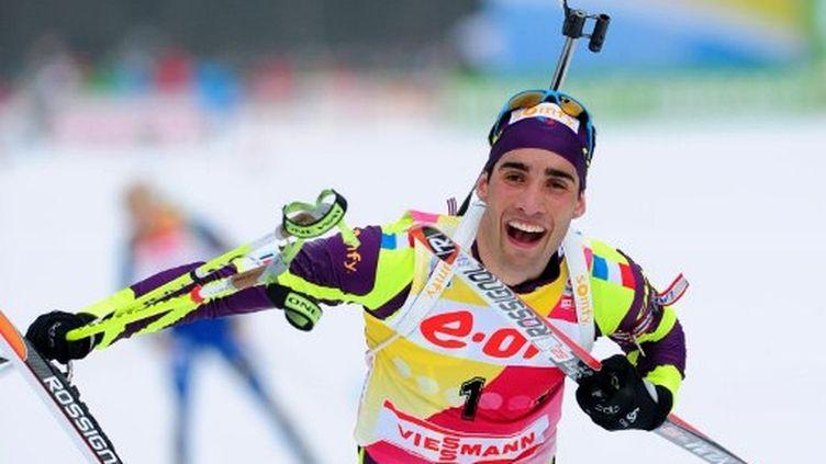 Le biathlète français Martin Fourcade a remportél'épreuve de poursuite, le 4 mars 2012 àRuhpolding (Allemagne). (JOHANNES EISELE / AFP PHOTO)