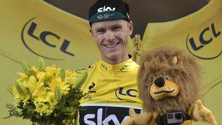 Le BritanniqueChristopher Froome, porteur dumaillot jaune du Tour de France, le 20 juillet 2015 à Gap (Hautes-Alpes). (LIONEL BONAVENTURE / AFP)