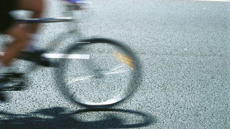 Image illustration d'un cycliste (FRÉDÉRIC CIROU / MAXPPP)