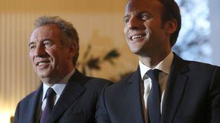 François Bayrou et Emmanuel Macron, le 23 février 2017, au Palais de Tokyo à Paris. (JACQUES DEMARTHON / AFP)