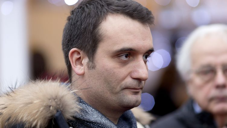 Florian Philippot visite le marché de Noël des Champs-Elysées, à Paris, le 22 décembre 2014. (KENZO TRIBOUILLARD / AFP)