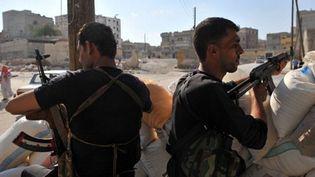 Rebelles syriens à un checkpoint à Alep (nord), le 24 juillet 2012 (AFP - BULENT KILIC)