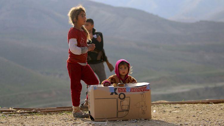 (Yézidis sur le mont Sinjar en Irak ©  REUTERS)