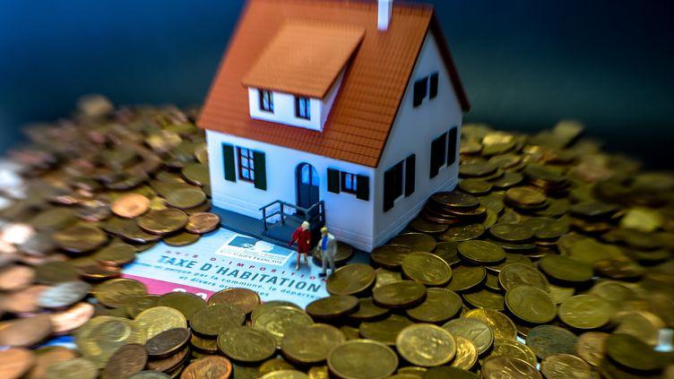 En 2020, quelque 80% des Français n'auront plus à acquitter de taxe d'habitation. (PHILIPPE HUGUEN / AFP)