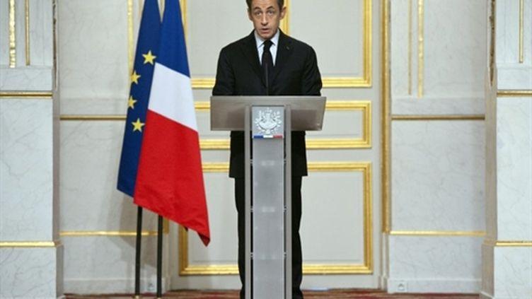 Le président Nicolas Sarkozy annonce que les avions français sont déjà en Libye, à l'issue d'un sommet à Paris (AFP - Lionel BONAVENTURE)