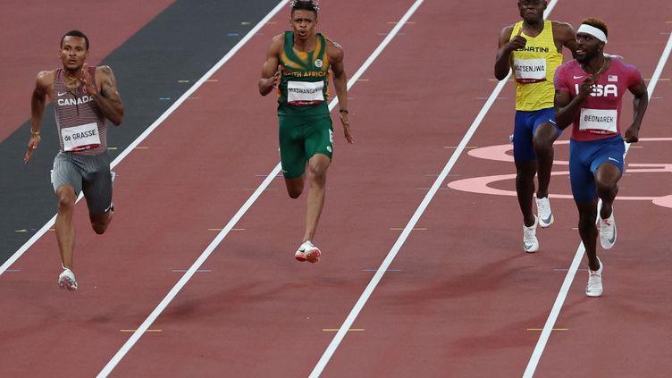 Le Canadien André de Grassea signé le meilleur temps des demi-finales de 200 m aux Jeux olympiques de Tokyo, le 3 août 2021. (GIUSEPPE CACACE / AFP)