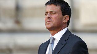 Le ministre de l'Intérieur, Manuel Valls, à Paris, le 23 août 2013. (CHARLES PLATIAU / REUTERS)