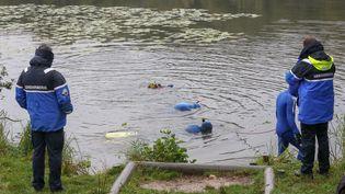 Des plongeurs ont notamment fouillé l'étang Neuf à Villefontaine (Isère) où Victorine a été portée disparue. (MICHEL THOMAS / MAXPPP)